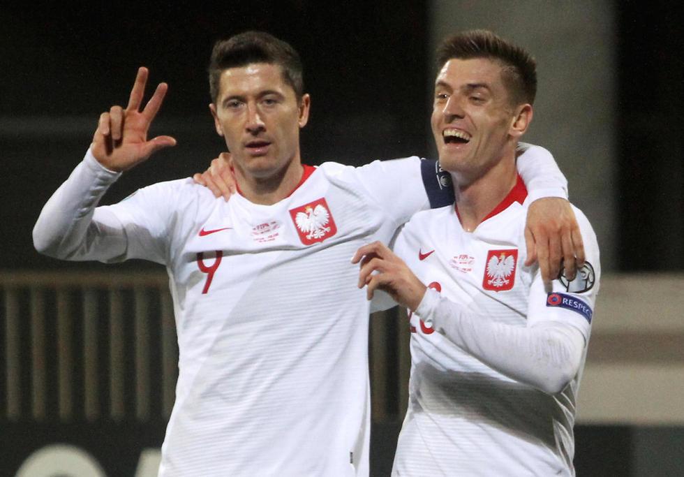 Robert Lewandowski y Krzysztof Piątek