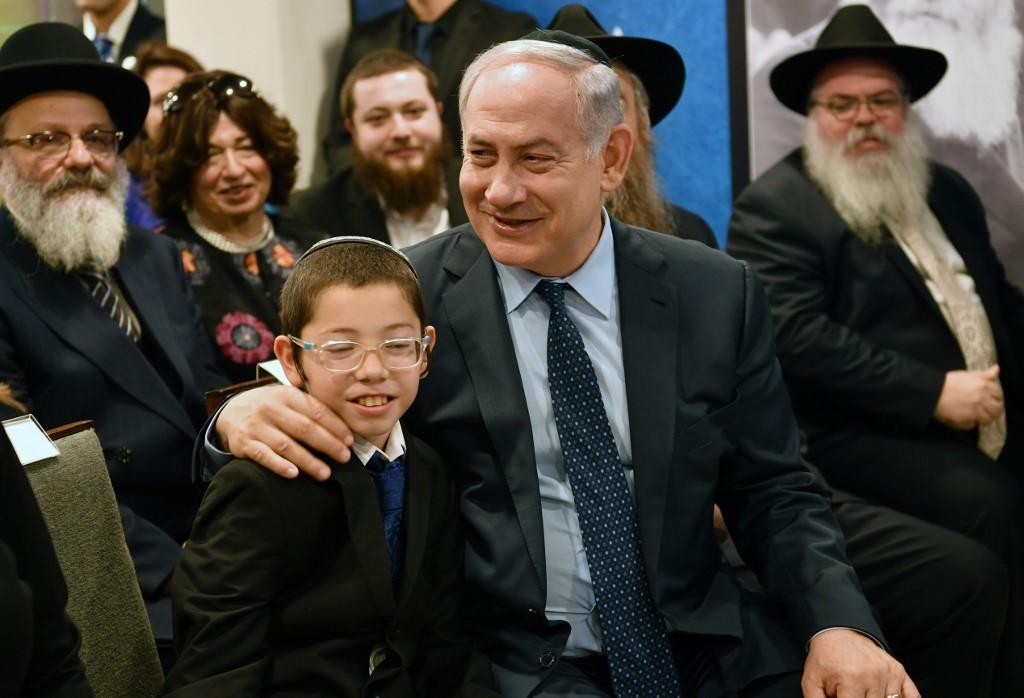 Moshe junto al primer ministro Netanyahu