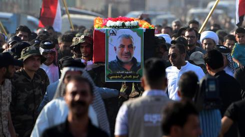 Miembros de Hezbollah durante el funeral de Soleimani en Irak