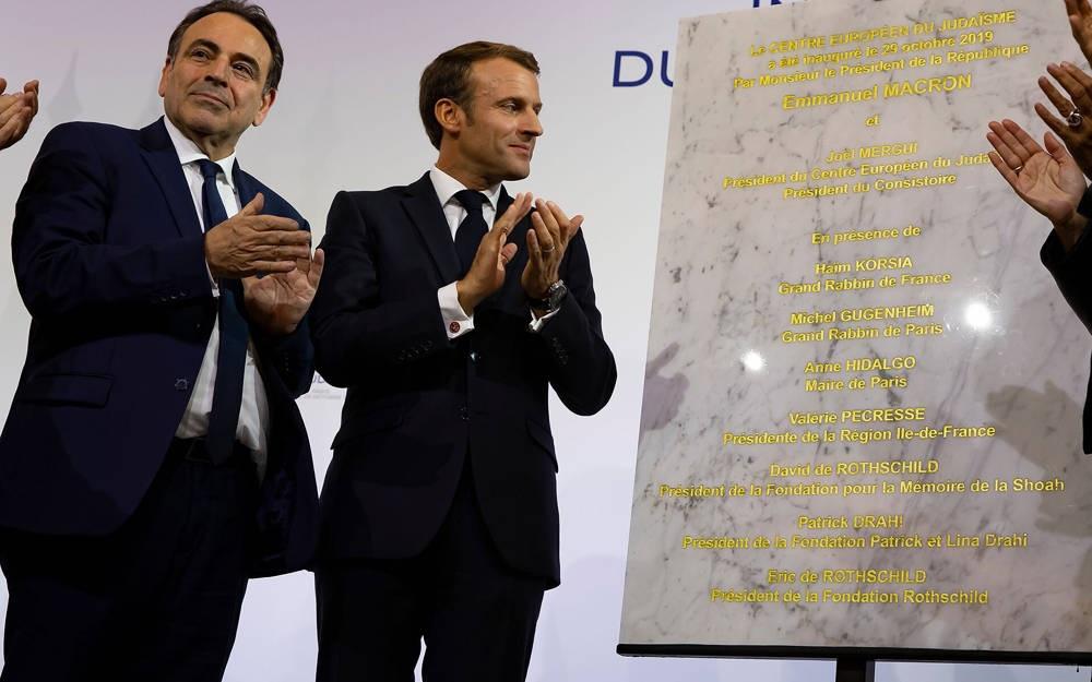 El presidente del Consistorio, Joel Mergui, y el presidente francés, Emmanuel Macron, en octubre de 2019. Mergui se recuperó del coronavirus.