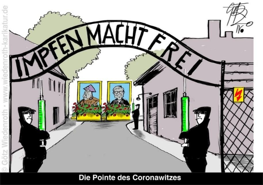 """El portón de entrada al campo de concentración y de exterminio de Auschwitz, en el que se lee """"la vacuna libera"""", en sustitución de la frase original """"el trabajo libera""""."""