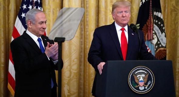 El presidente de Estados Unidos, Donald Trump, y el primer ministro israelí, Benjamin Netanyhau, en la presentación del plan de paz de Estados Unidos.
