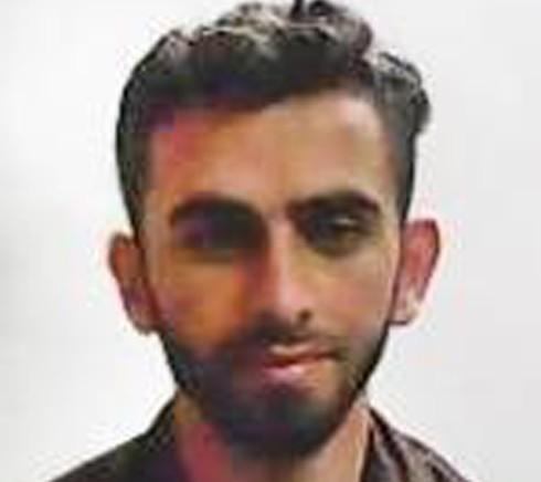 El agente fugitivo de Hamás Izz al-Din Hussein.