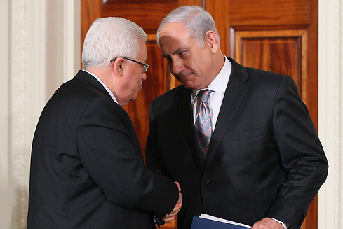 Abbas, presidente de la Autoridad Palestina, junto a Benjamín Netanyahu.