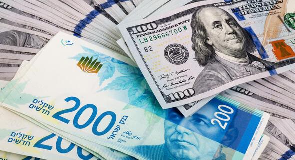 Shekels y dólares. El tipo de cambio actual perjudica al sector tecnológico de Israel.