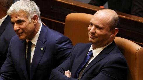 El canciller Yair Lapid y el primer ministro Naftalí Bennett.