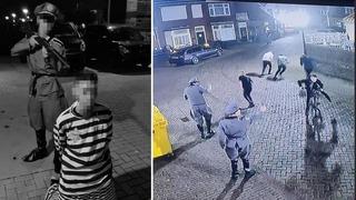 """Un """"oficial nazi"""" apunta con su rifle a la cabeza de un """"prisionero judío"""" y las imágenes captadas por las cámaras de seguridad."""