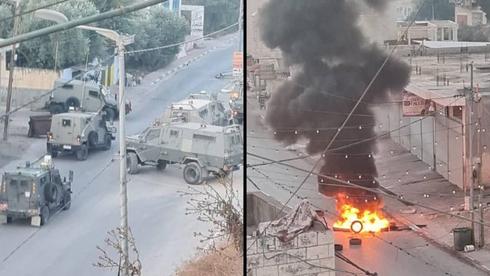 Palestinos chocan con las tropas israelíes cerca de Jenin después de la redada del domingo.
